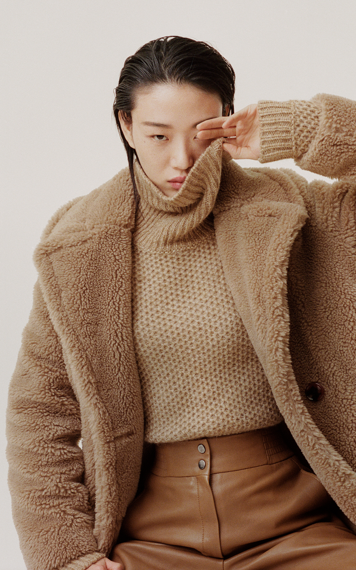 Girl with a teddy coat in camel