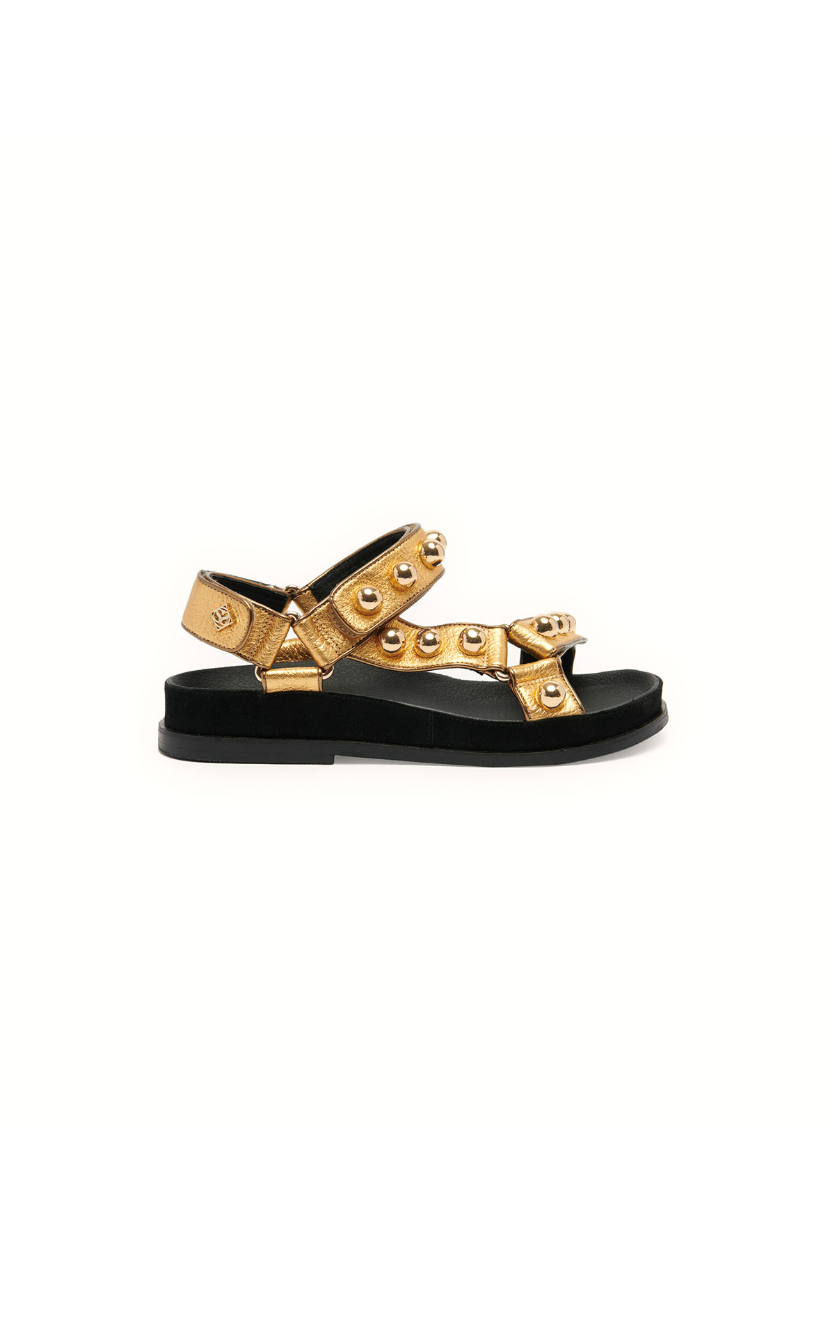 Sandro flat leather sandals at The Bicester Village Shopping Collection