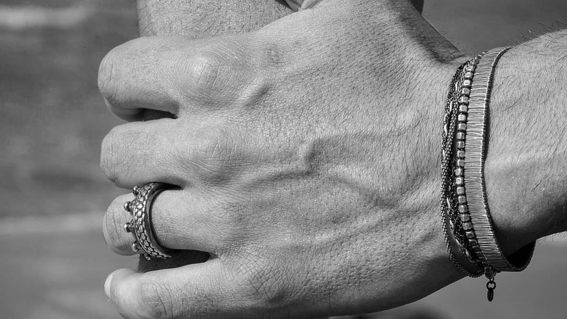 Man's hand with jewelry