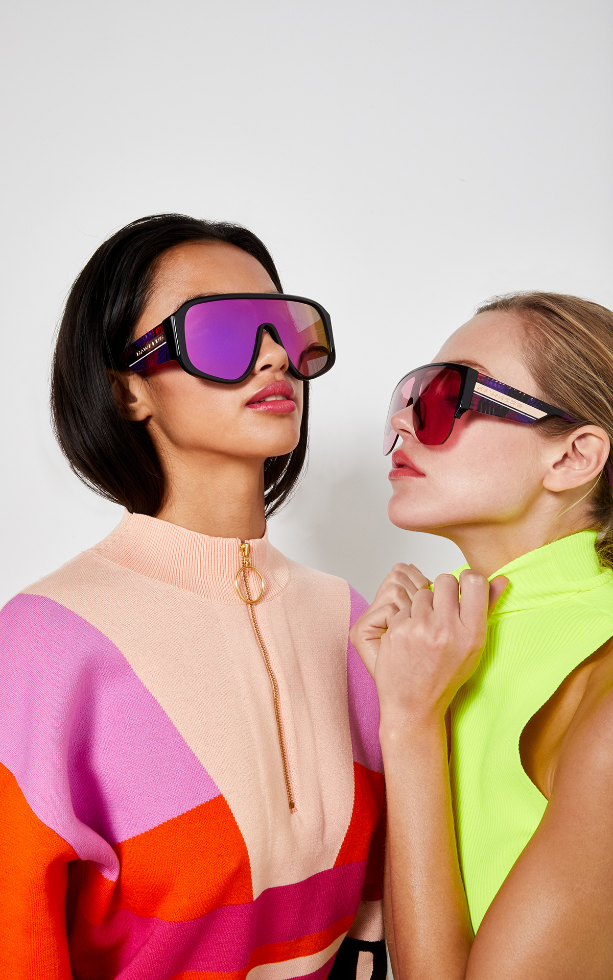 Women with sunglasses and neon clothes