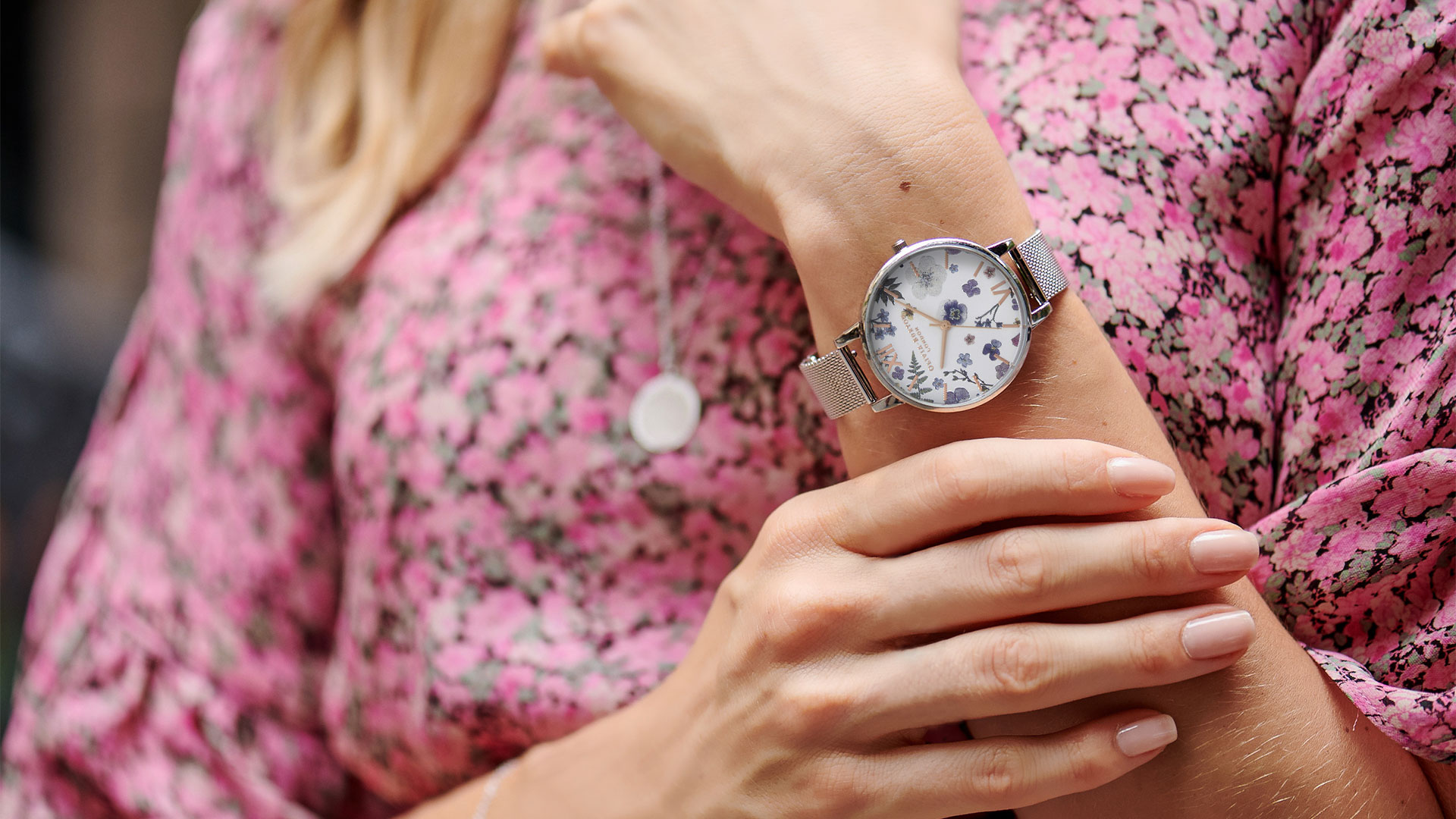 Olivia Burton main image lady wearing silver watch at Bicester Village
