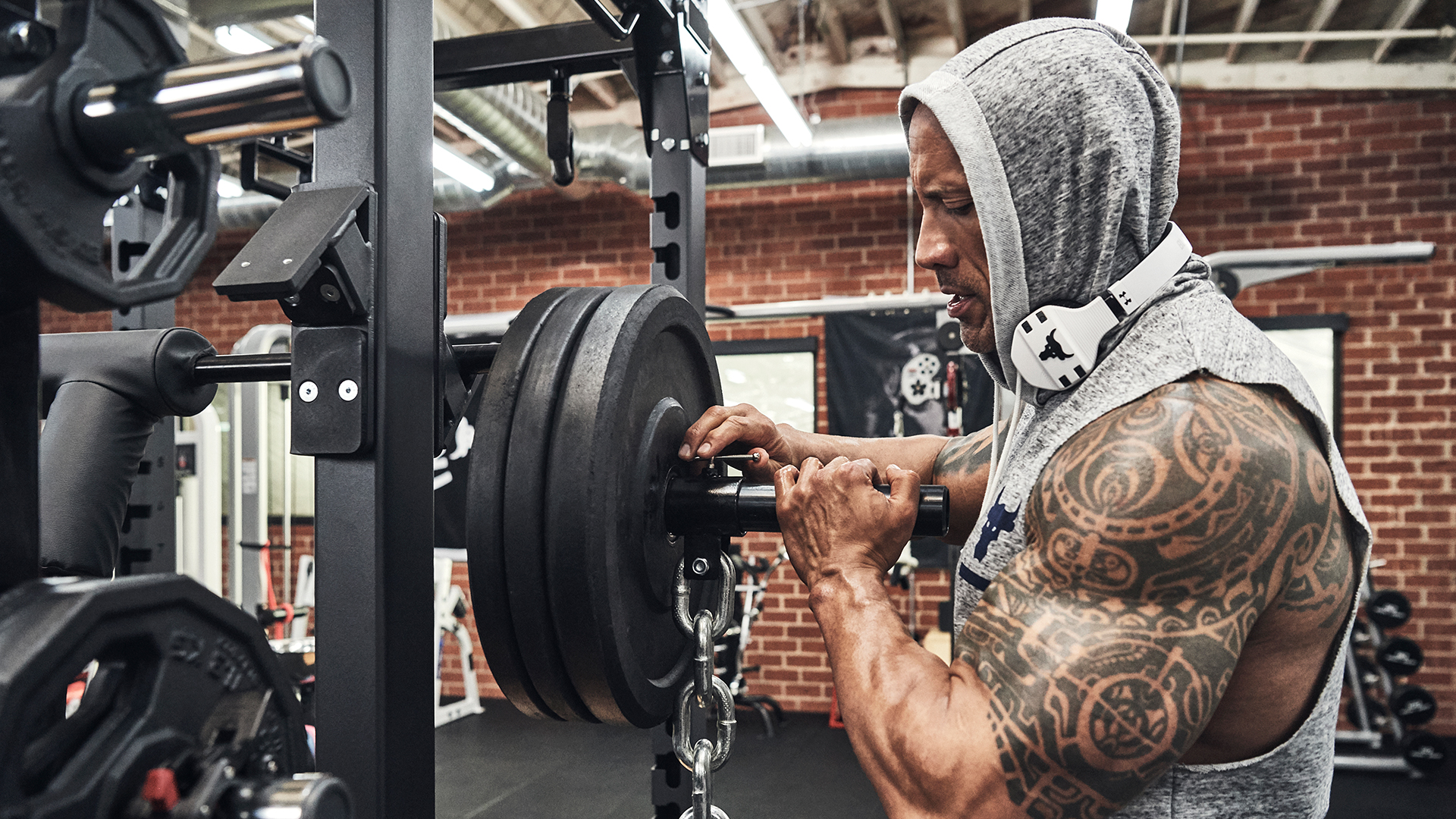 Dwayne 'The Rock' Johnson lifting weights in Under Armour tank