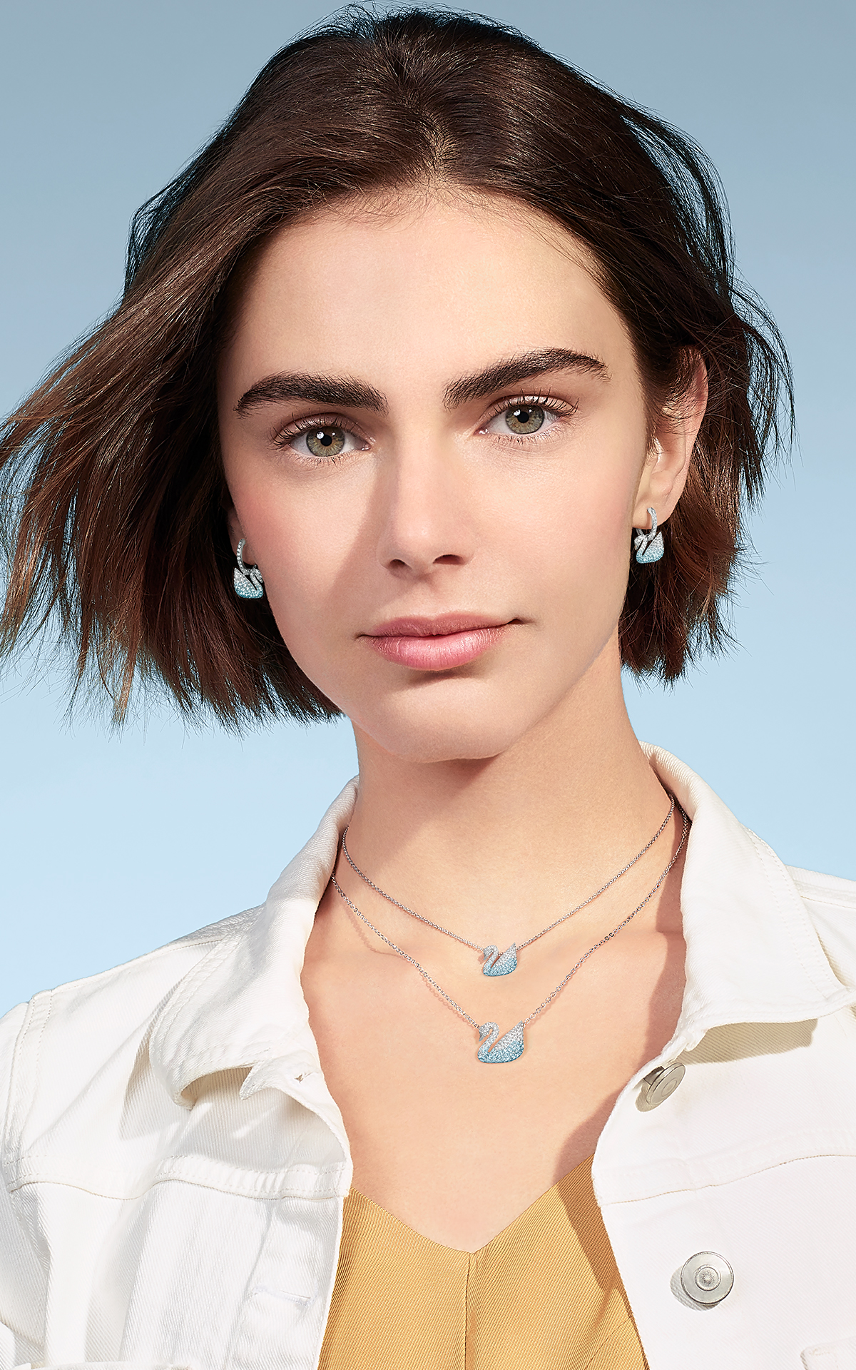 Short haired girl wearing Swarovski jewelry