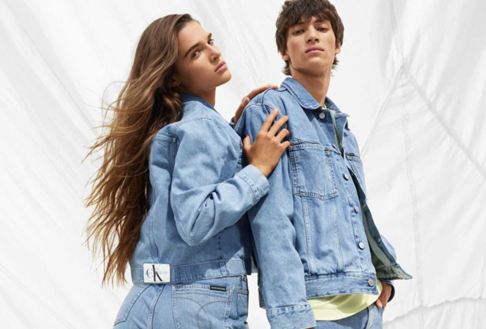 Woman and man dressed with denim clothes