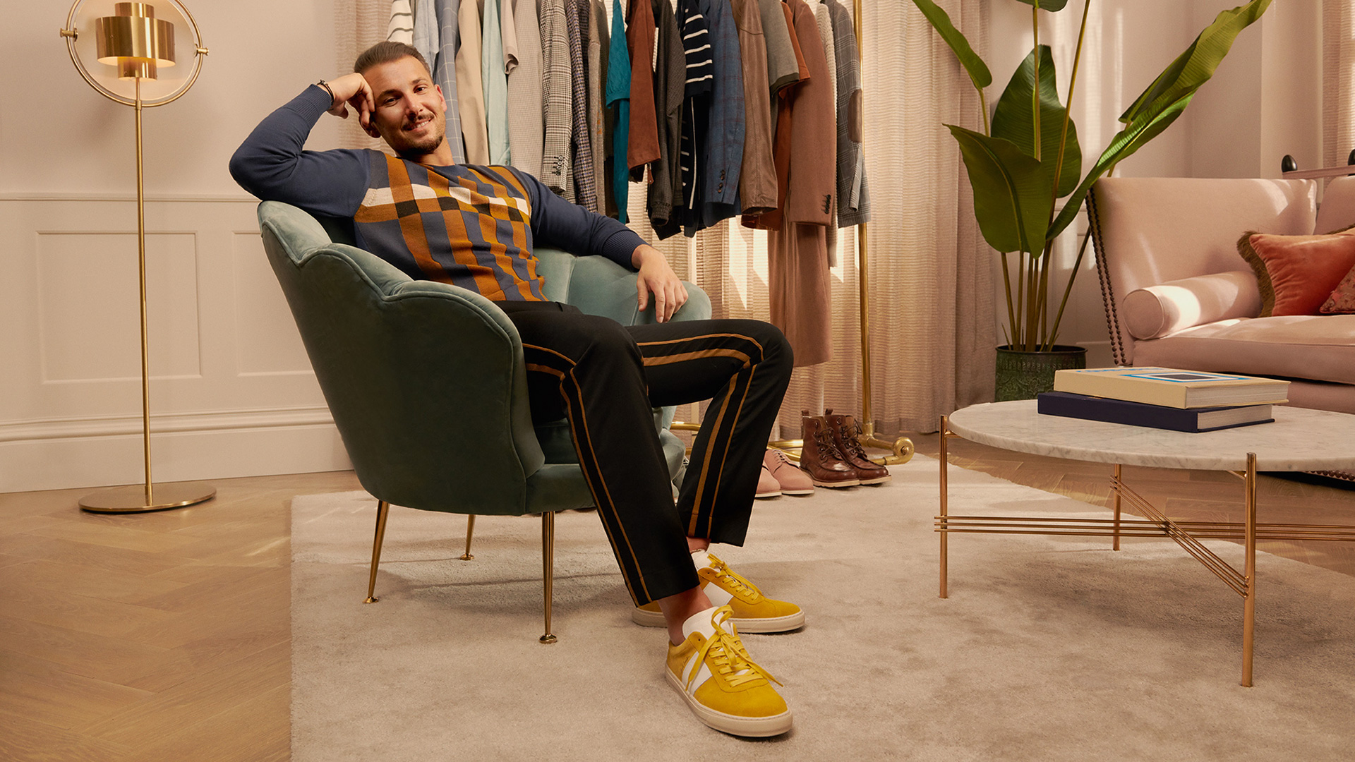 Sandro Rasa poses on the set of The Bicester Village Shopping Collection's autumn campaign shoot
