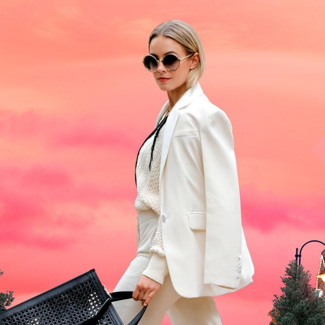 Woman with a white suit walking in Las Rozas Village
