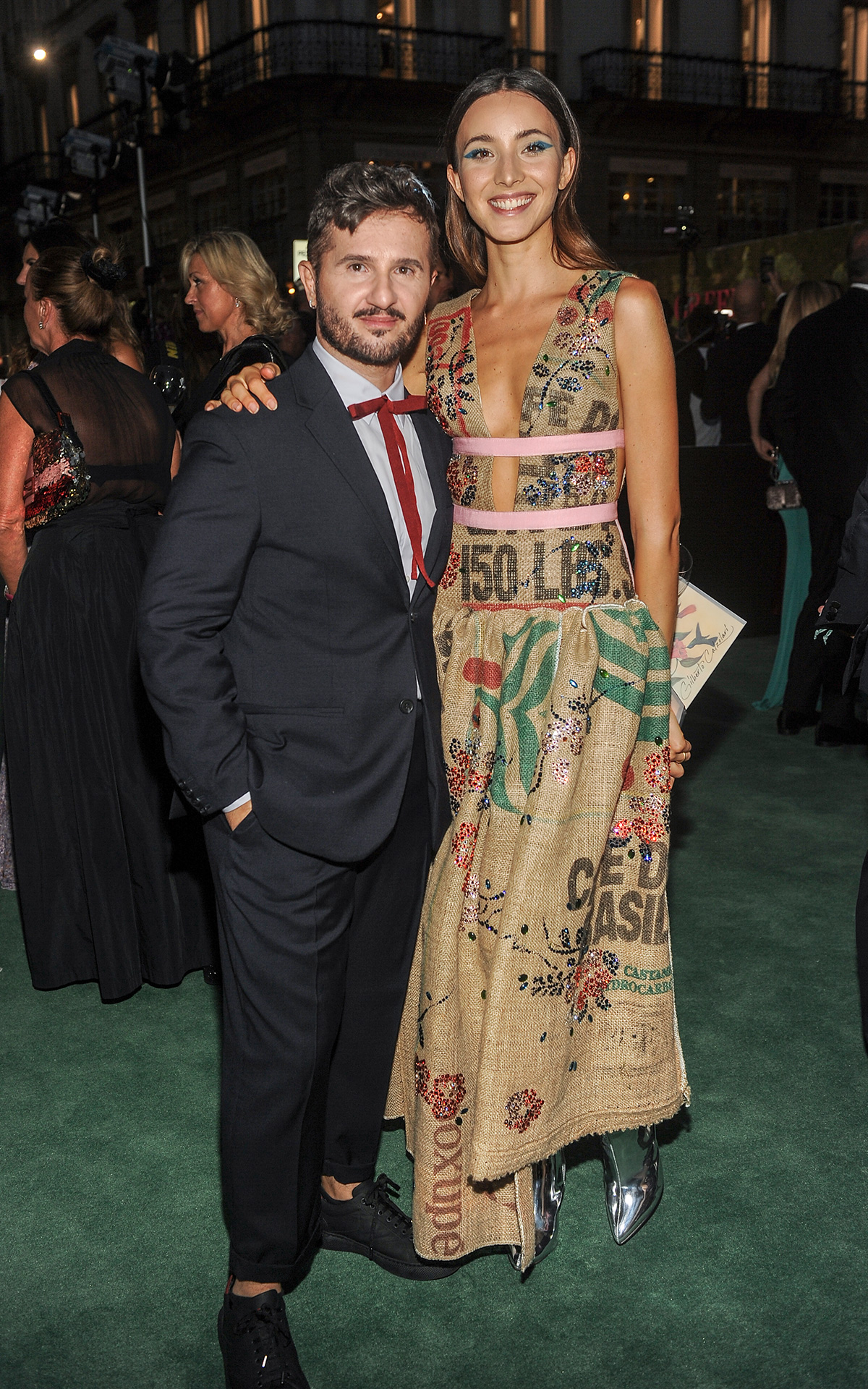 Gilberto Calzolari posing with Federica Delsale at the Green Carpet Challenge Awards