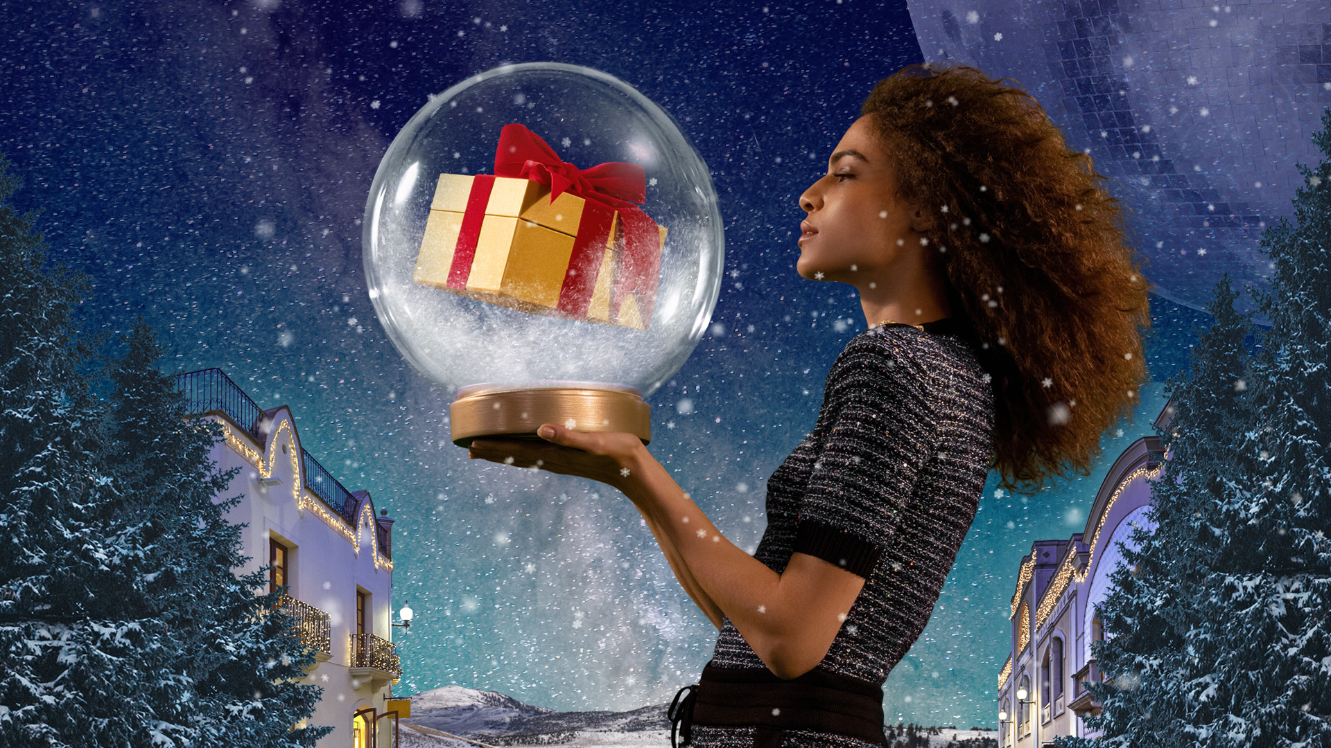 Woman with a snow ball with a present