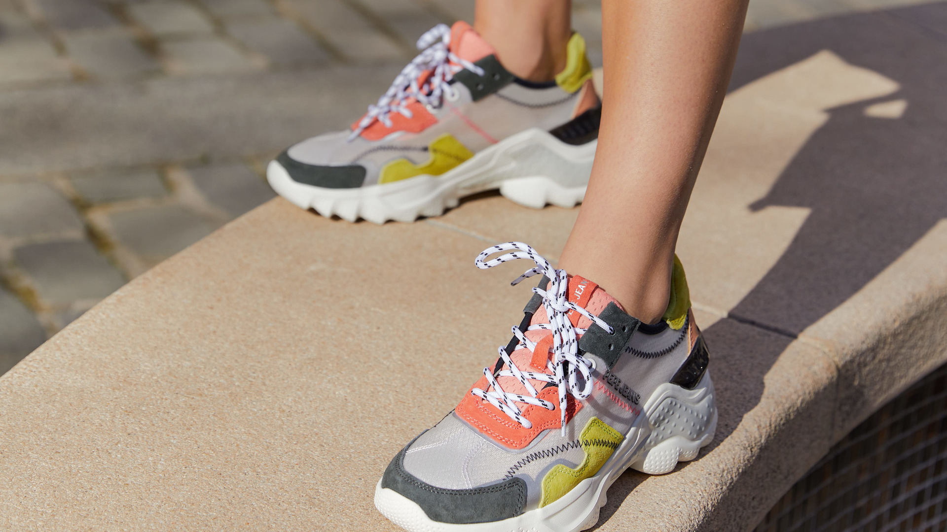 Woman with colorful sneakers from Bimba y Lola