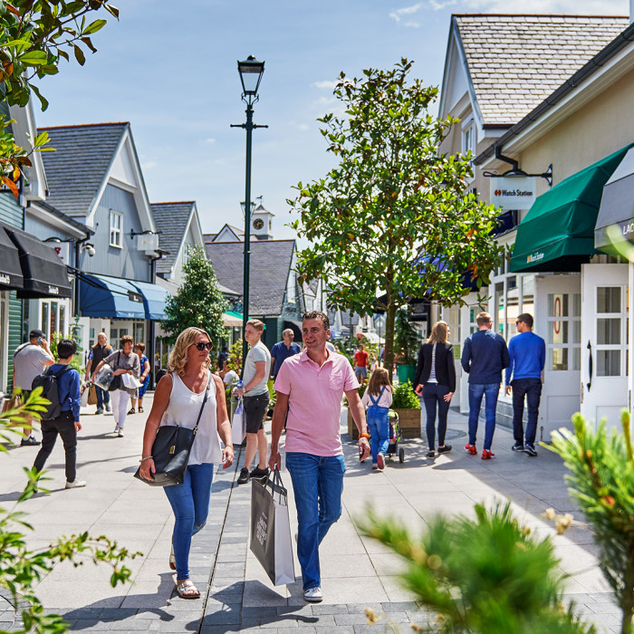 Kildare Village busy main mall on sunny day