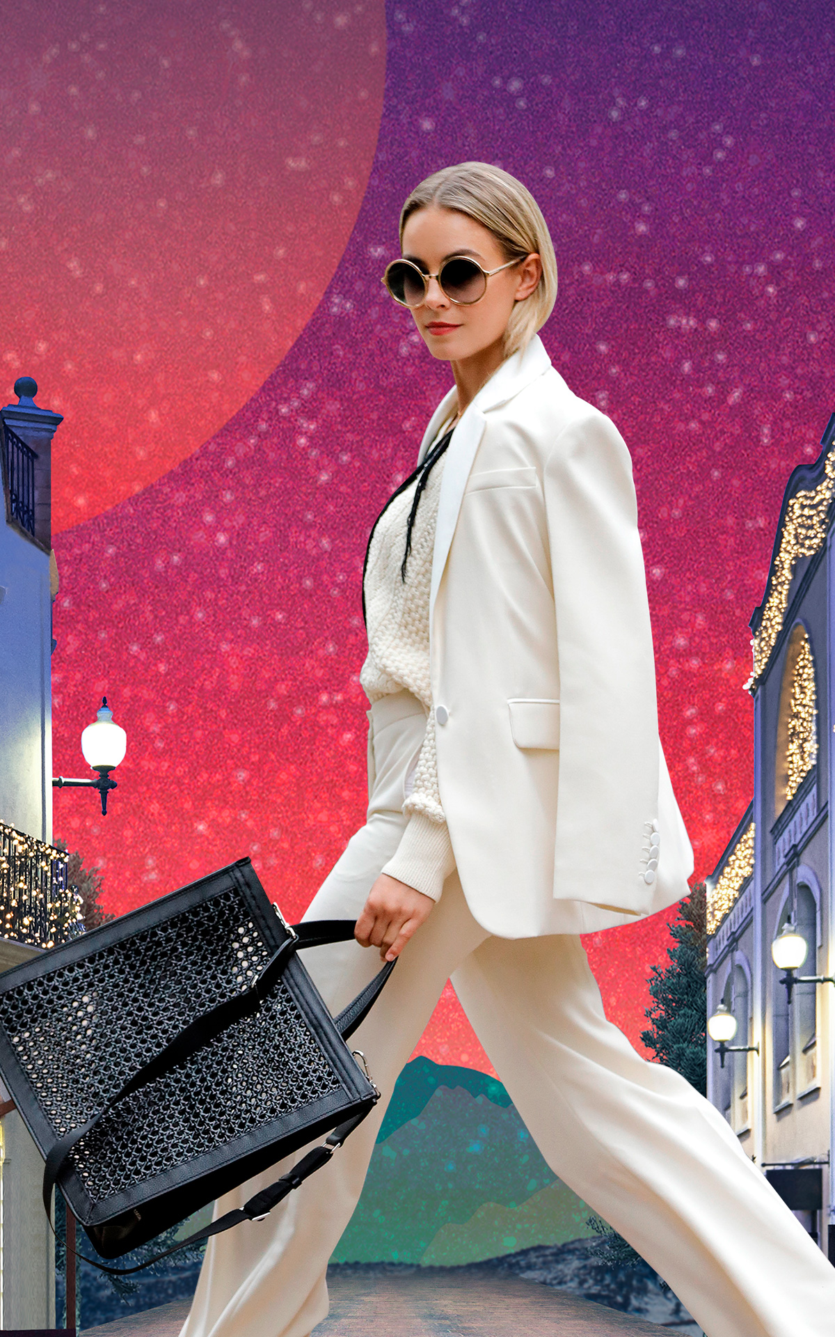 Woman with a white suit and a black bag walking