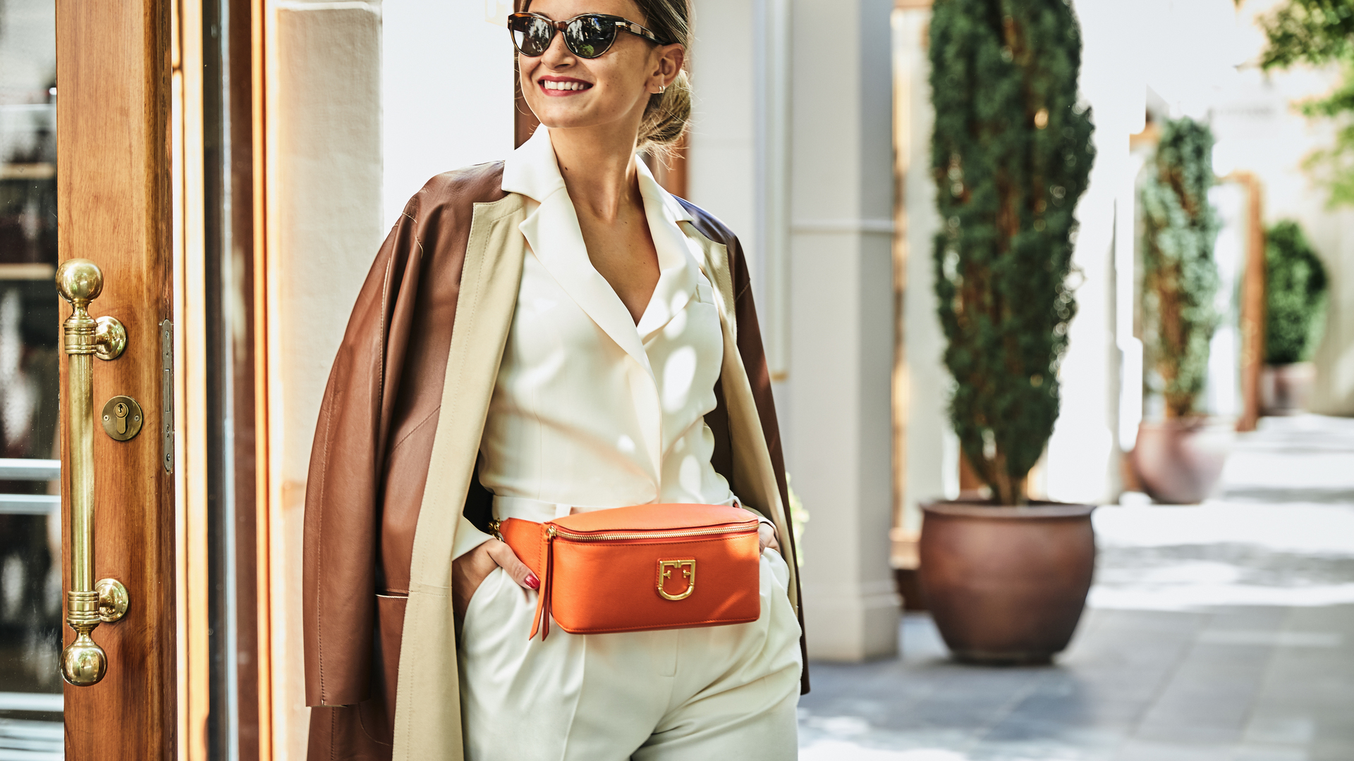 Smiling girl with orange fanny pack