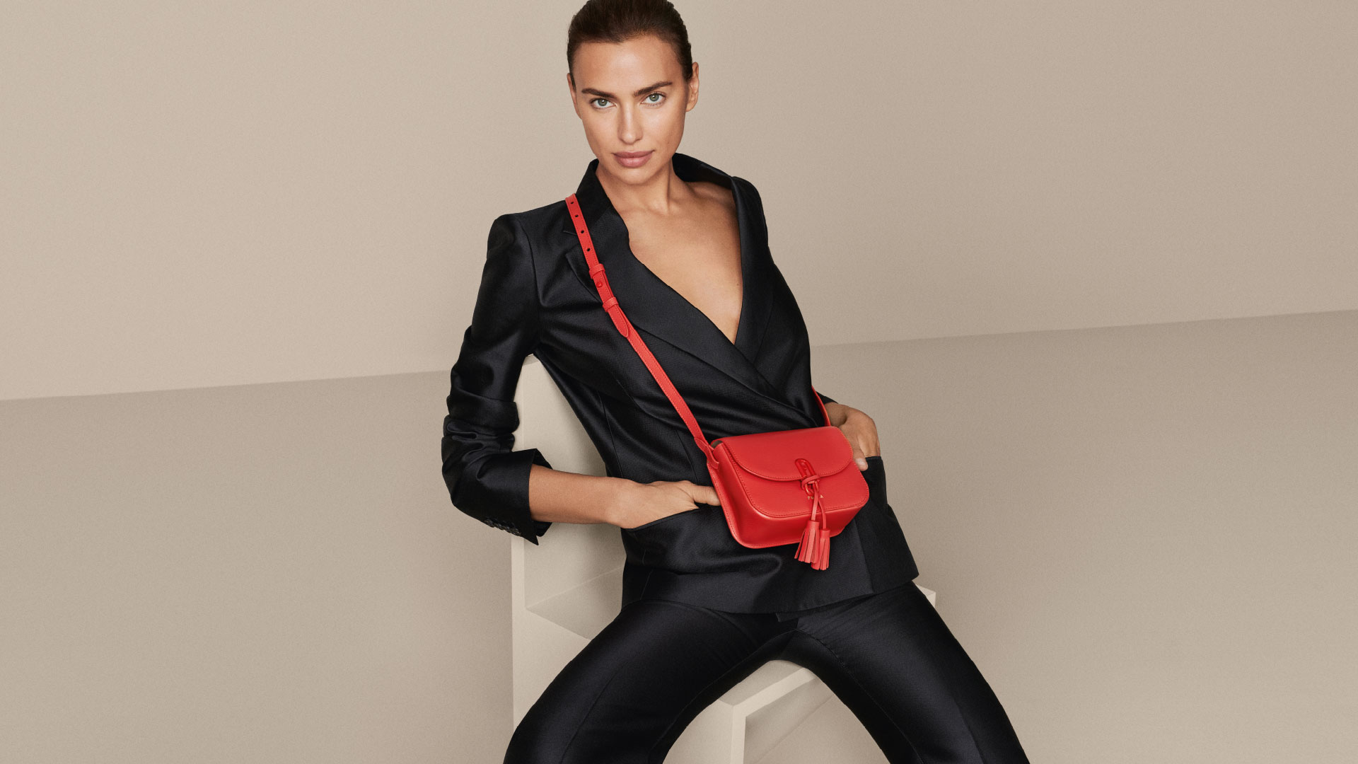 Irina Shayk collaboration with Furla wearing a red bag