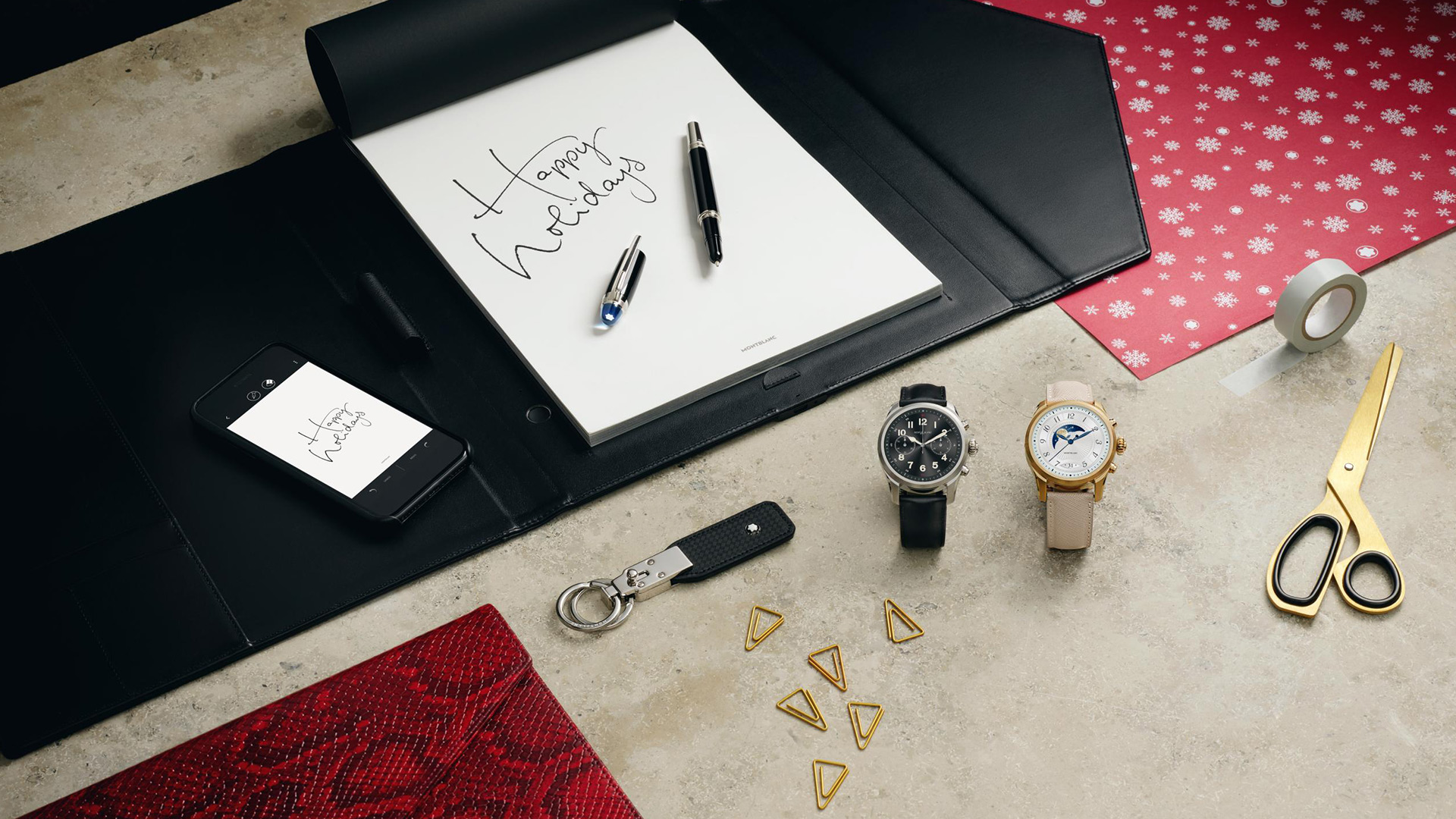 Father and son writing with Montblanc stationary