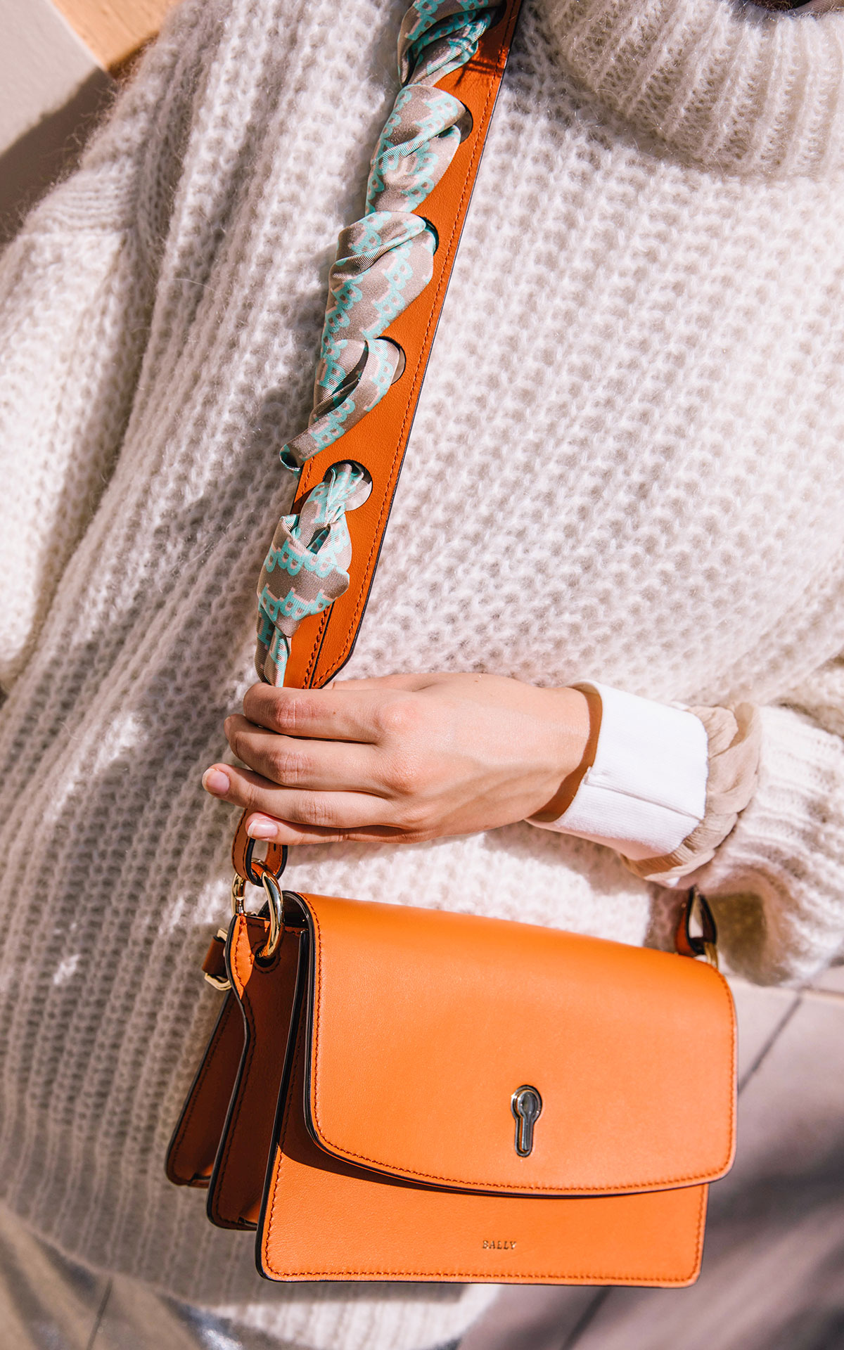 Woman with a orange shoulder bag