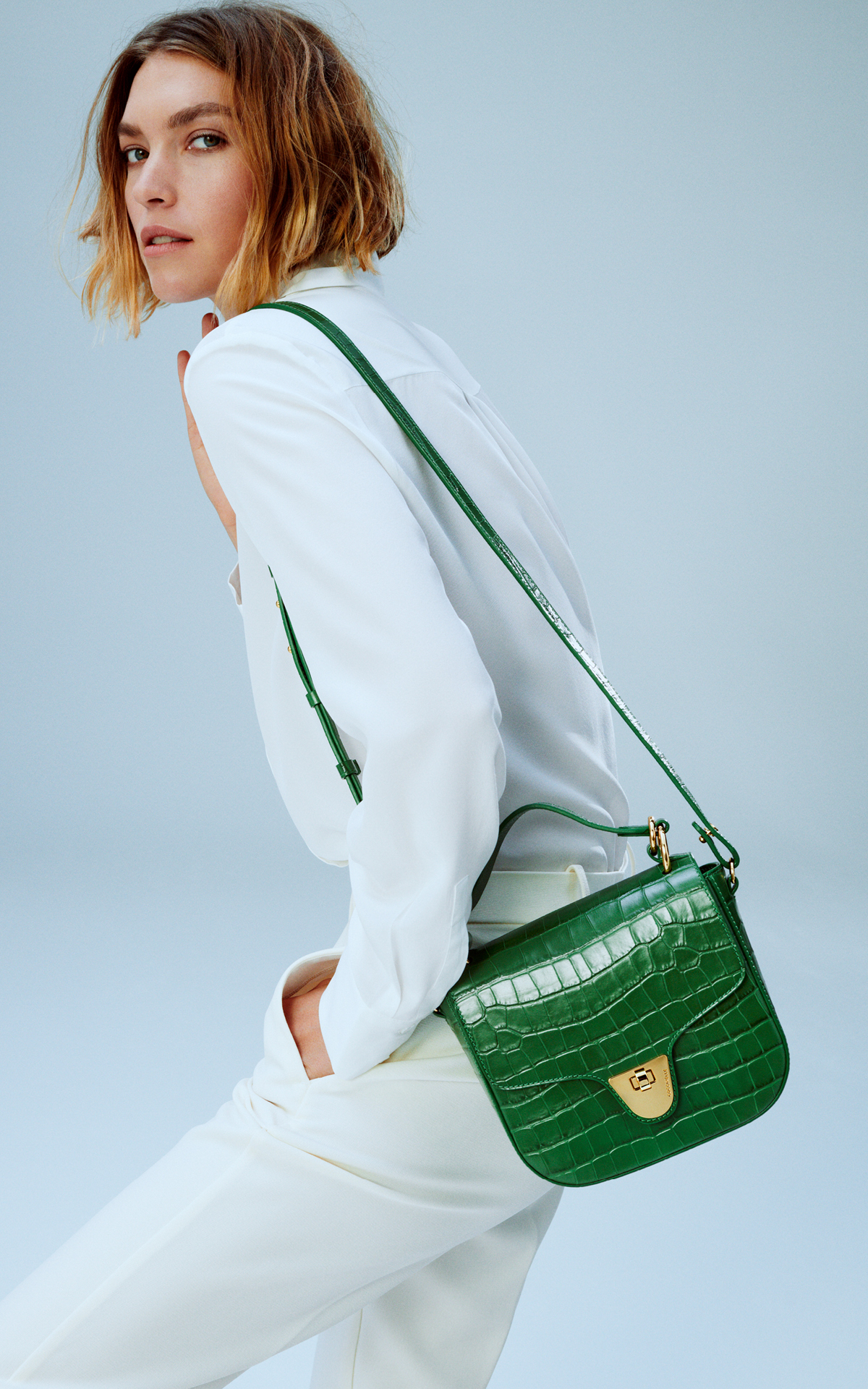 girl with a green coccinelle bag