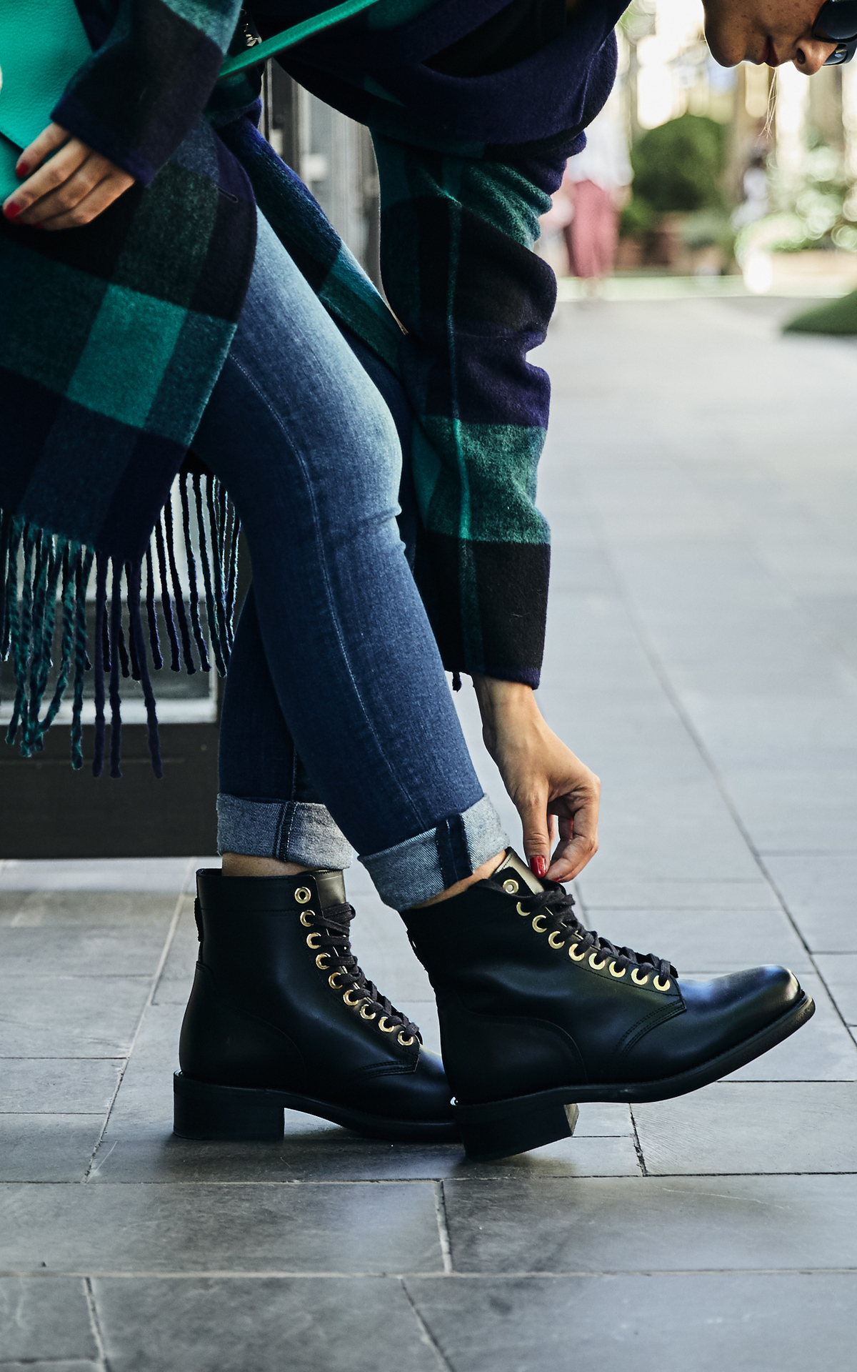 Woman with black combat lace boots