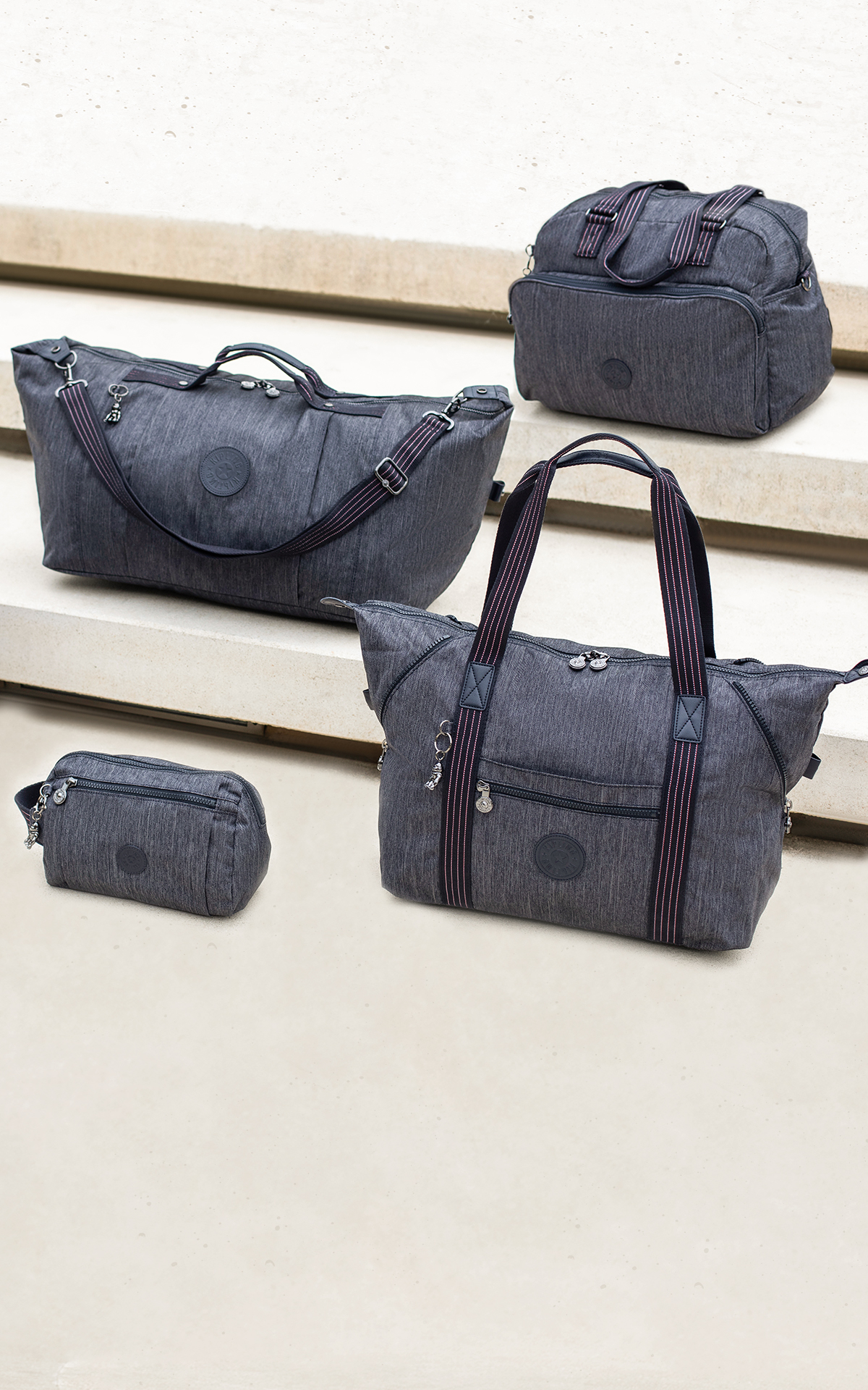 Different size grey bags Kipling